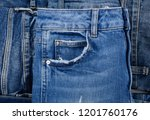 stack of stripy blue jeans... | Shutterstock . vector #1201760176