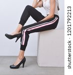 female legs in colorful stripy... | Shutterstock . vector #1201792213