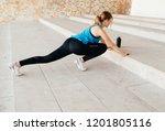 sports girl doing push ups  | Shutterstock . vector #1201805116