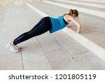 sports girl doing push ups  | Shutterstock . vector #1201805119