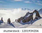 Skiiers walking to the aiguille percee in Espace Killy the ski resorts of Tignes and Val D