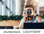 young bearded hipster man with... | Shutterstock . vector #1201973059