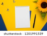white notepad with blue... | Shutterstock . vector #1201991539