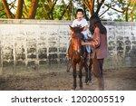 kid with special needs is... | Shutterstock . vector #1202005519