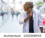 afro american doctor man over... | Shutterstock . vector #1202008933