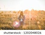 girl closed her eyes  praying... | Shutterstock . vector #1202048026