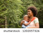 african american mother holding ...   Shutterstock . vector #1202057326