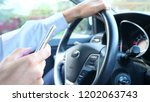close up of hands and steering... | Shutterstock . vector #1202063743