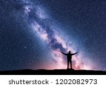 milky way and silhouette of a... | Shutterstock . vector #1202082973