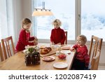 kids having breakfast on... | Shutterstock . vector #1202087419