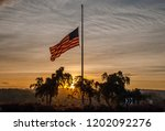 american flag at half mast.... | Shutterstock . vector #1202092276