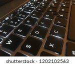 a keyboard landscape with black ... | Shutterstock . vector #1202102563