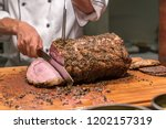carving of wagyu beef roast | Shutterstock . vector #1202157319