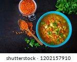red lentil soup on dark... | Shutterstock . vector #1202157910
