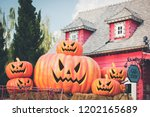 group of halloween pumpkin in... | Shutterstock . vector #1202165689