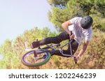 bmx freestyle rider wearing... | Shutterstock . vector #1202246239