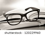 a pile of books and glasses... | Shutterstock . vector #120229960