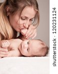 a mother kisses the handle of... | Shutterstock . vector #120231124