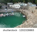 fishing boats at clovelly... | Shutterstock . vector #1202328883
