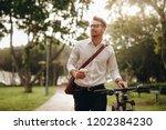 businessman listening to music... | Shutterstock . vector #1202384230