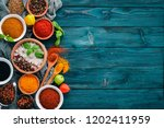 spices and herbs on a blue... | Shutterstock . vector #1202411959