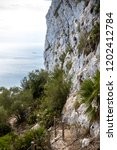 A footpath on the Rock of Gibraltar. Gibraltar is a British Overseas Territory located on the southern tip of Spain - stock photo