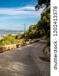 A road on the Rock of Gibraltar in the Upper Rock Nature reserve. Gibraltar is a British Overseas Territory located on the southern tip of Spain. - stock photo