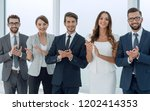 business team applauding while... | Shutterstock . vector #1202414353