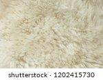 white shaggy natural sheep fur... | Shutterstock . vector #1202415730