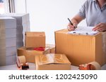 shipping staff are checking the ... | Shutterstock . vector #1202425090