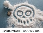 a pile of salt from salt shaker ... | Shutterstock . vector #1202427106