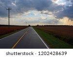 the sun streams between the...   Shutterstock . vector #1202428639