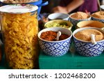 flavoring of noodles in a... | Shutterstock . vector #1202468200