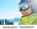 portrait of man at the ski... | Shutterstock . vector #1202556019