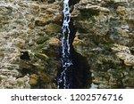 falling from the cliffs... | Shutterstock . vector #1202576716