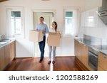 full length millennial wife and ...   Shutterstock . vector #1202588269