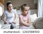 woman scolding little girl.... | Shutterstock . vector #1202588503