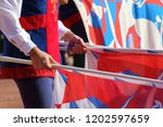 competitions of the flag wavers ... | Shutterstock . vector #1202597659