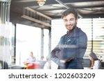 portrait of happy businessman... | Shutterstock . vector #1202603209