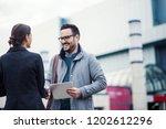 businessman and businesswoman... | Shutterstock . vector #1202612296