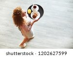 young wavy haired waitress... | Shutterstock . vector #1202627599