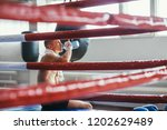 male boxer drinking water after ... | Shutterstock . vector #1202629489