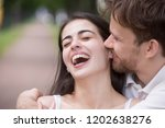 loving man tickling and... | Shutterstock . vector #1202638276