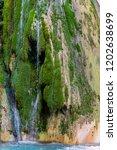 waterfall of water between the ... | Shutterstock . vector #1202638699