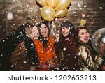 group of girls celebrating and... | Shutterstock . vector #1202653213
