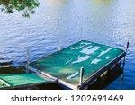 floating docks with old carpet...   Shutterstock . vector #1202691469