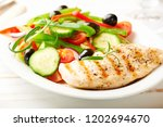 grilled chicken breast with... | Shutterstock . vector #1202694670