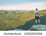 tall man in outdoor clothes... | Shutterstock . vector #1202696506