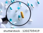 suspicious medications under a... | Shutterstock . vector #1202705419