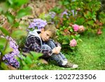 unhappy and miserable. little... | Shutterstock . vector #1202723506